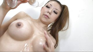 pretty and horny asian chick oils herself