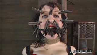 clothespins on her face