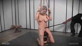 submissive rain degrey restrained in hard bondage
