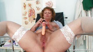 Granny Nurse Masturbating With A Big Dildo At The Work
