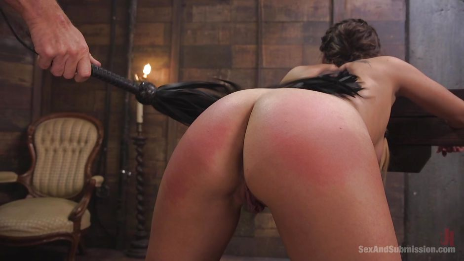 Tits whipped for brunette tied in the cross