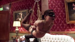 Blindfolded Brunette Bitch Hanging From The Ceiling