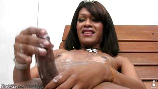 Dark Haired Shemale Puts Tons Of Lotion On Her Monstercock