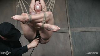 Redhead Is Bound Tightly In Rope