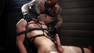 Black Leather Mask And Tight Rope Bondage