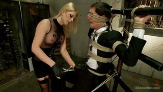 Sexy Blonde Transsexual Babe Ties A Suited Dude