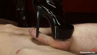 Shemale Steps On Her Slaves Cock In Heels