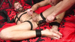 Bound And Gagged Hunk Takes A Vibrator In The Ass