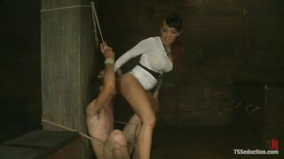 Transexual Dominatrix Rubs Her Ass In Her Slave's Face