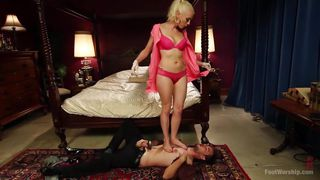 Blonde Dominatrix Sticks Her Feet In Slave's Face