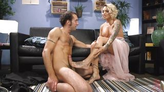 Sweet Tranny Sucks Her Man And Gives A Footjob